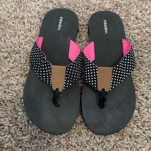 Black and white polka dot flip flops